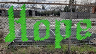 Hope spelled out on fence in lime green